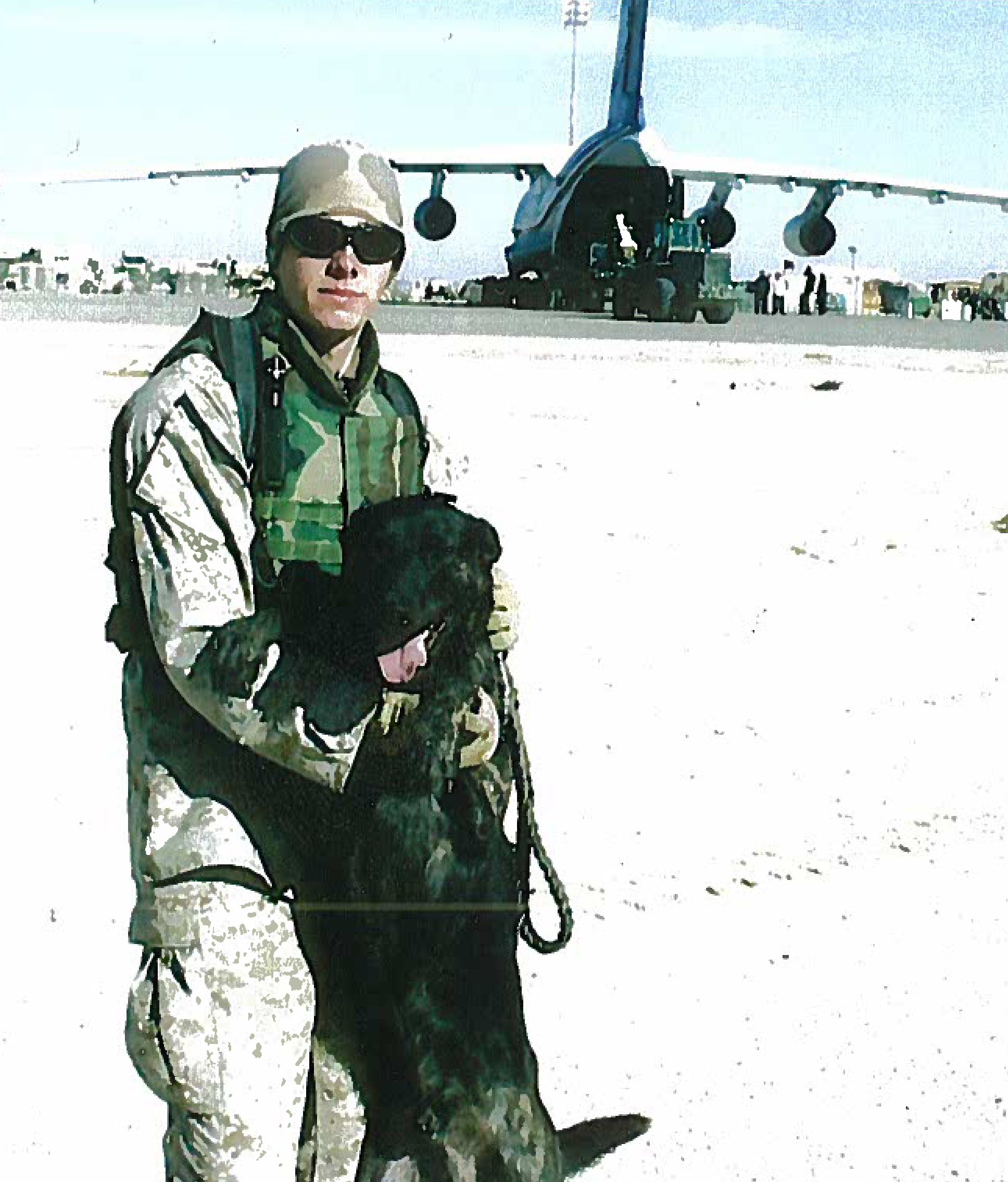 Chris completing his first combat deployment in 2004 with MWD Marco F281. Photo taken at Al Asad Iraq.