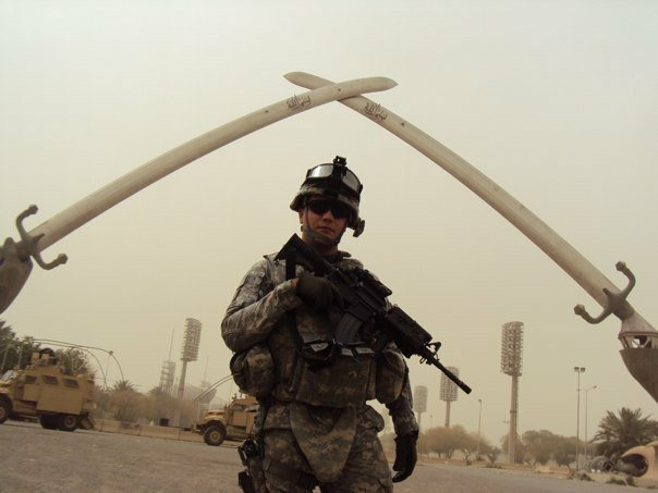 Tyler at the Arc of Triumph (also known as the Cross Sabres) in Baghdad, Iraq in 2010.