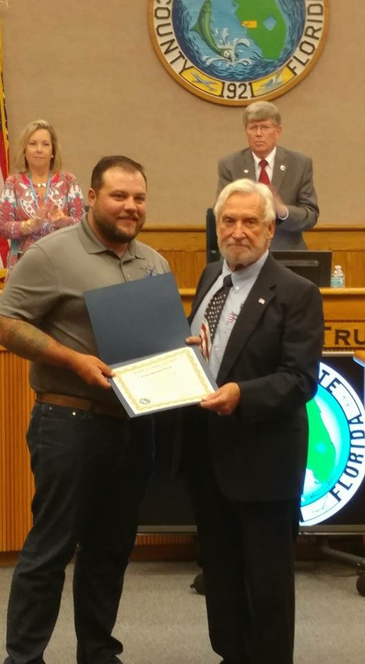 Tyler being recognized for being a combat wounded veteran by the Charlotte County Commissioner, Stephen R. Deutsch in 2017.