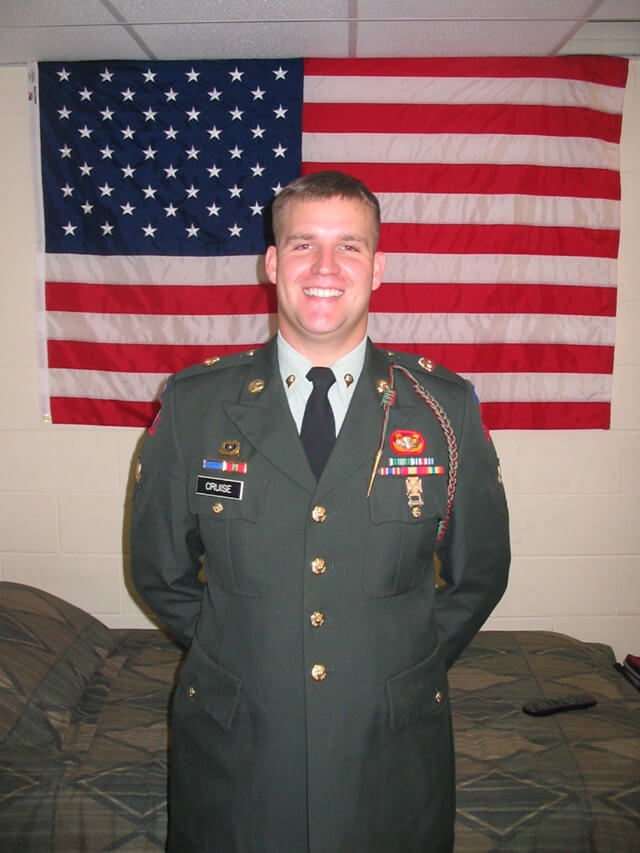 Chris in dress greens while in barracks room