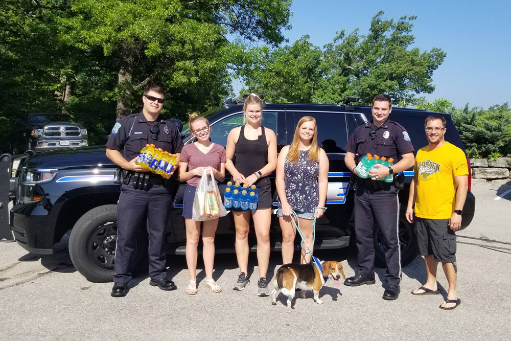 Members of MSW Team delivering drinks to Lake of the Ozarks Firefighters during a very hot day.  MSW team (left to right) – Katlyn Bartels, Abby Hetlage, Chasiti Begley, Keith Lucas.