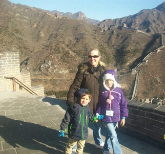 Terri with her kids at the great wall of China, while on leave from her station in South Korea