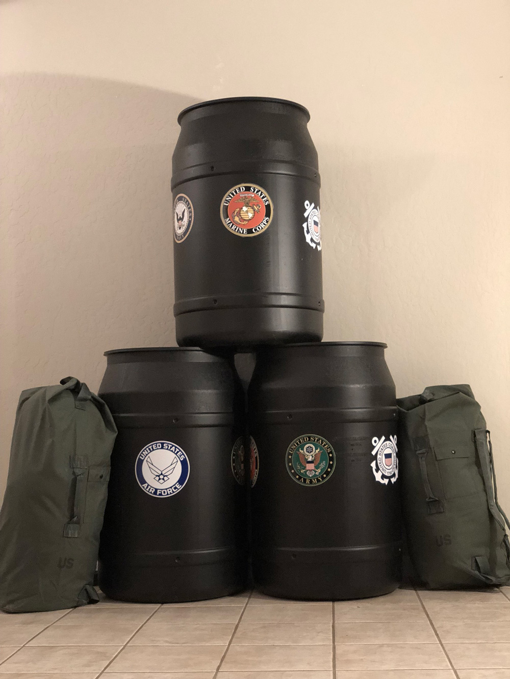 Donation collection barrels created by Tracey's organization Opertion Good to Go. The barrels are placed in businesses in order to collect supplies for veterans in need.