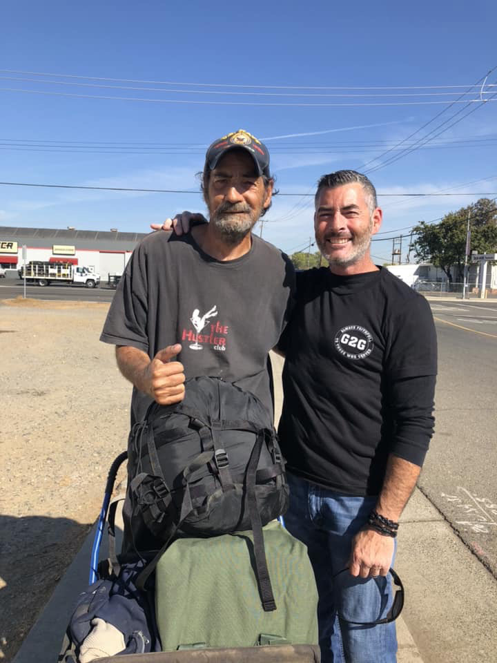 Tracey delivering a sea bag to a veteran in need
