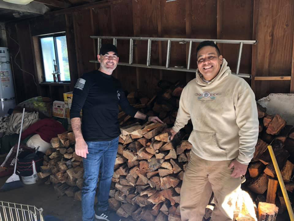 Owner of Action Whitewater Adventures Mike Juarez donating firewood to a veteran in need.