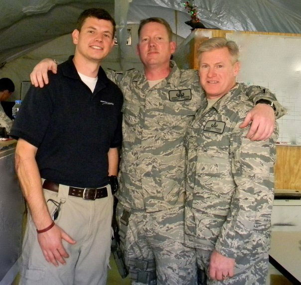 Adam with two of his former senior leaders in Afghanistan.