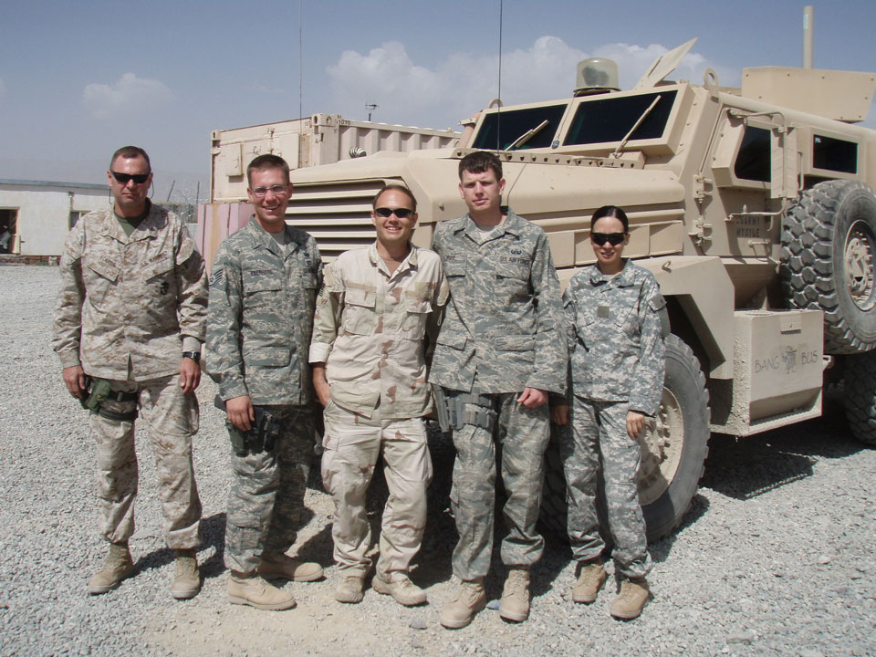 Adam with his EOD teammate, Combined Explosives Exploitation Cell members, and their translator.