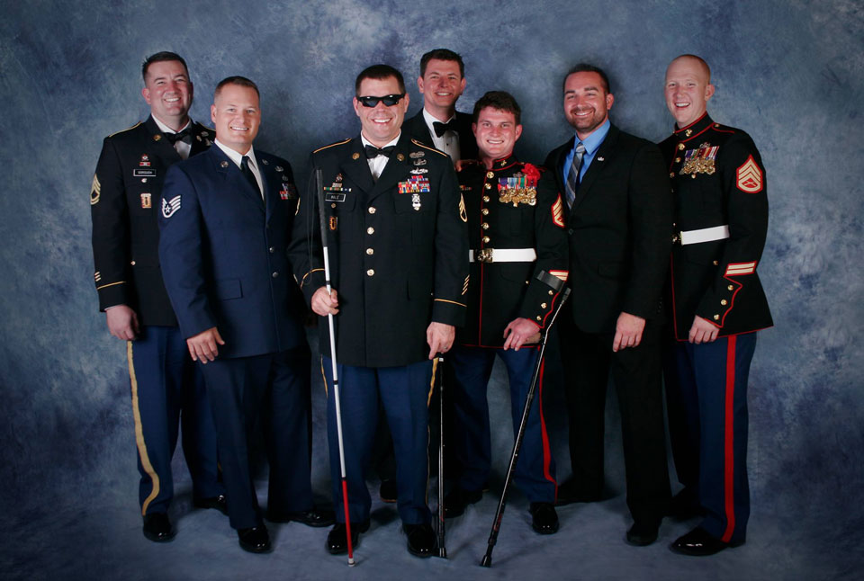 Adam with several combat wounded friends at the annual EOD Memorial and Ball.