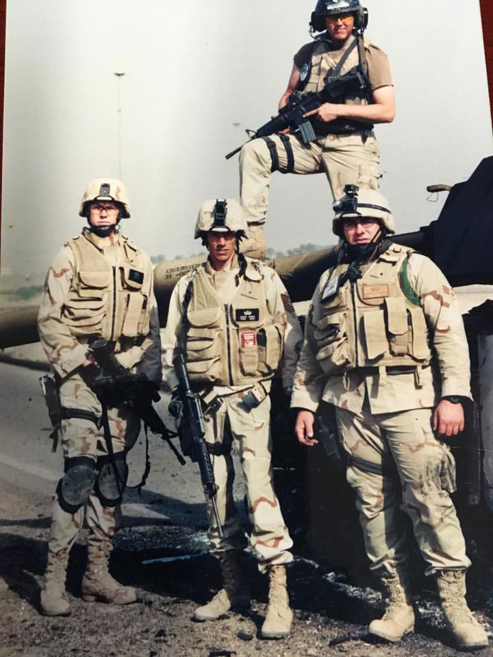 Adam in Baghdad with his EOD Team and their security.