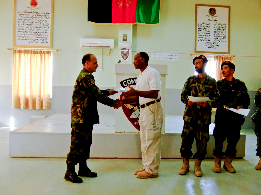 Receiving his leadership award from 3rd Commando BDE. Commander Kandahar Airbase, Afghanistan, 2011