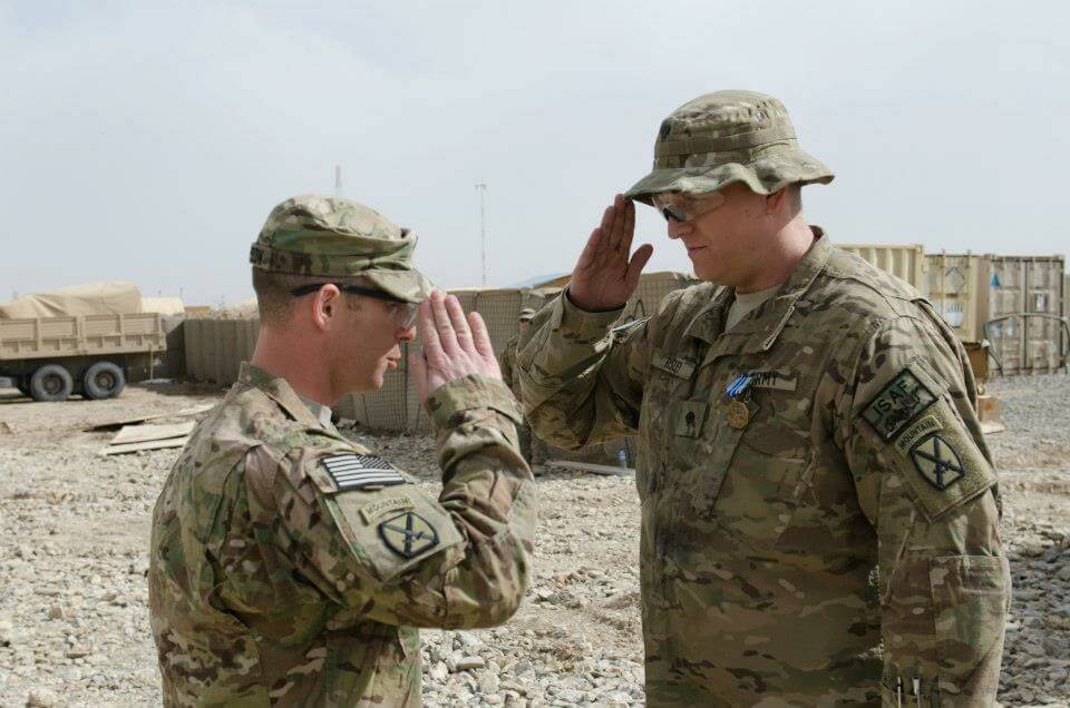 Saluting his commanding officer after receiving the AAM during deployment