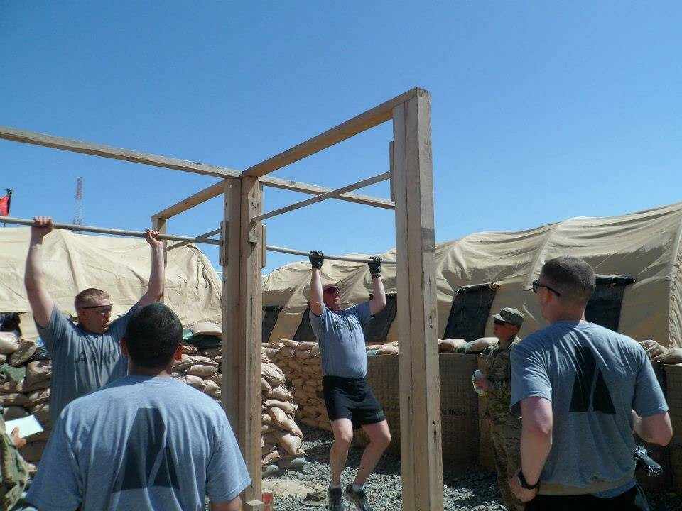Knocking out some pull-ups for a contest during deployment.