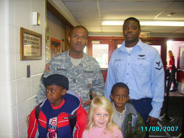 Military appreciation day at his daughter's school.
