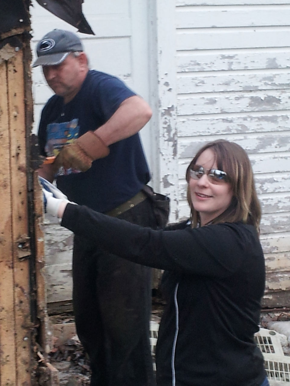 Dan and his daughter/nominator, Ashley tearing down an old garage.