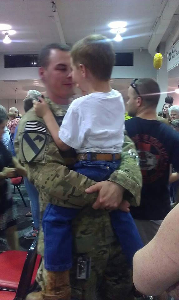 David embracing his son after a long deployment.