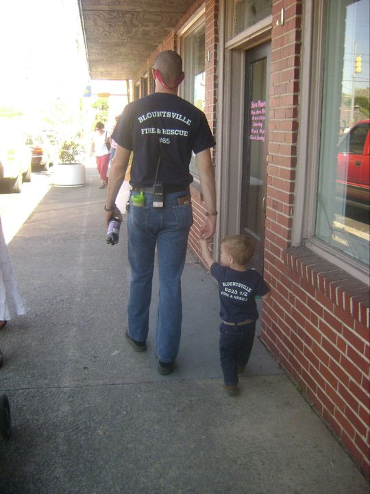 David teaching his son about the volunteer fire service.