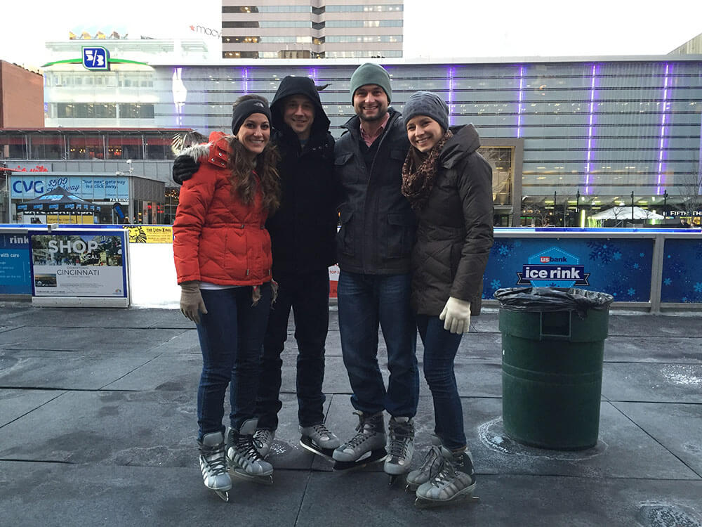 Mason with his wife and their friends at Fountain Square in Cincinnati