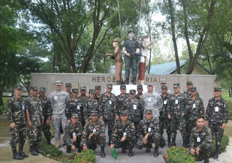 Mason Rick with his group of colleagues at Fort Ramon Magsaysay in the Philippines (in light green uniforms)