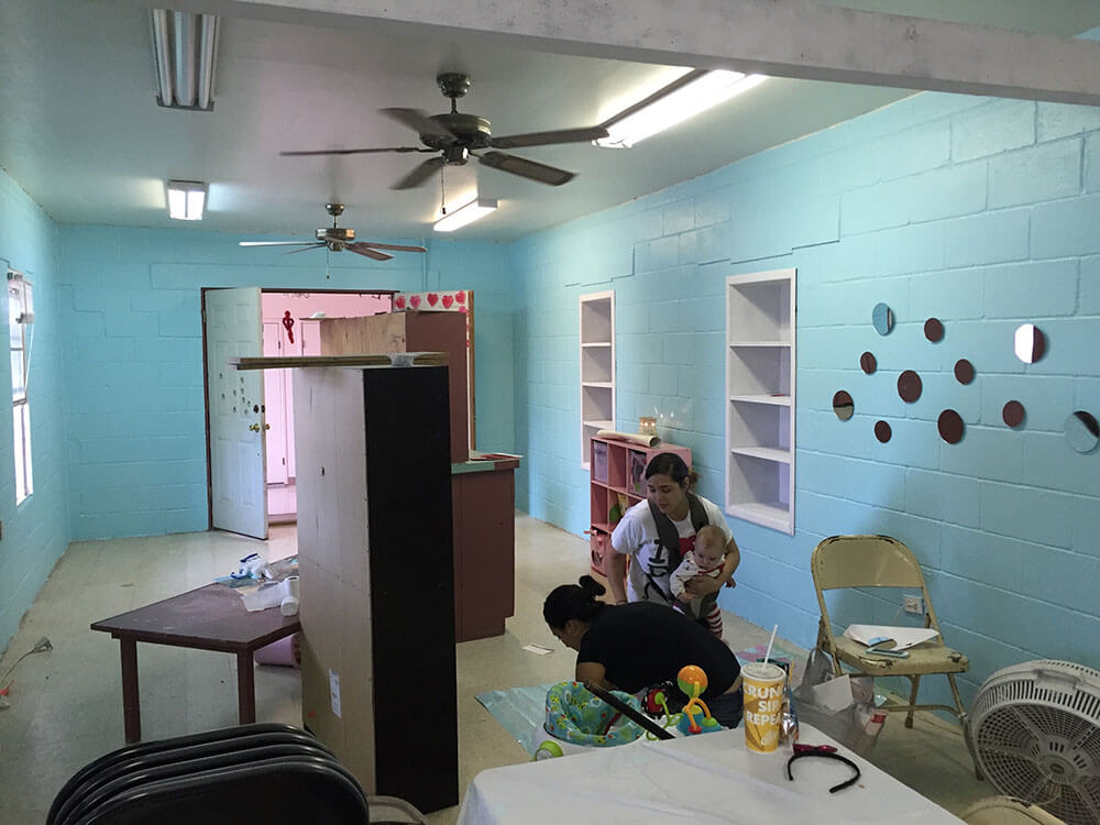 Ruby painting and redecorating the classroom for her Sunday School children